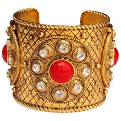 1990s Christian Dior gilded metal cuff with rhinestones and red cabochons