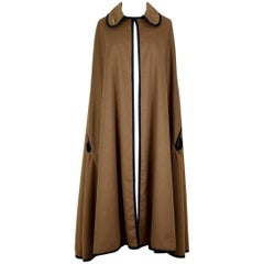 Roberta di Camerino 1970s Classic Black Trimmed Tan Wool Cape With Logo Brooch