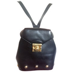 Vintage Salvatore Ferragamo black calf leather backpack with golden motif