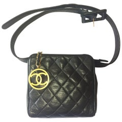 Vintage CHANEL black lambskin square shape fanny pack with golden round CC motif