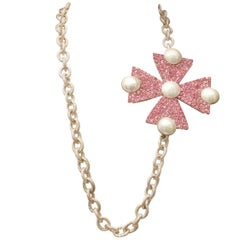 1980s, Yves Saint Laurent long necklace with a pink rhisnestone pendant cross