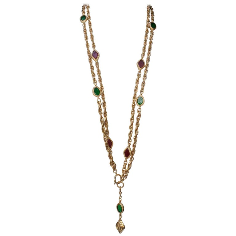 1990s, Chanel long gilded metal necklace with ruby and emerald elements For Sale