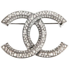 CHANEL Double C Brooch in Silver Plated Metal and Rhinestones