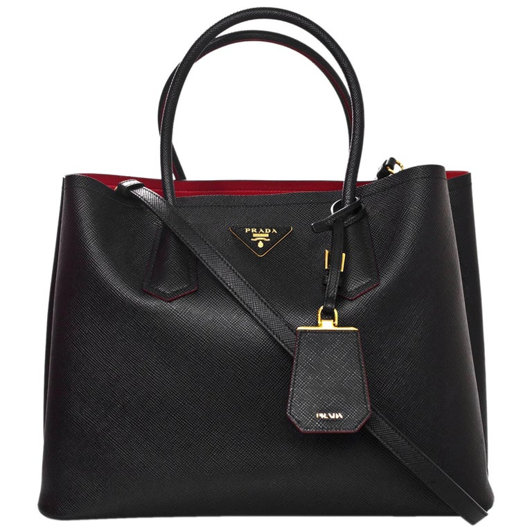 a5d33aa9ec Prada Black Saffiano Leather Double Handle Tote Bag w. Red Interior rt.  $2,780