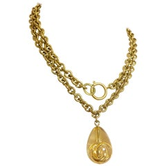 Vintage CHANEL long chain necklace with clear and gold teardrop CC pendant top.