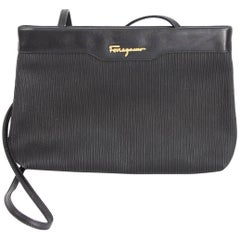 Salvatore Ferragamo black leather clutch bag cod. ad 211183 made italy 1980s