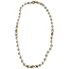 Vintage CHANEL Necklace in Molten Glass Pearls, Gilded Metal Charms