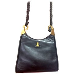 Vintage LANVIN black leather trapezoid shape shoulder bag with kiss lock closure
