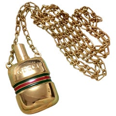 MINT. Vintage Gucci golden mini perfume bottle necklace with webbing line.