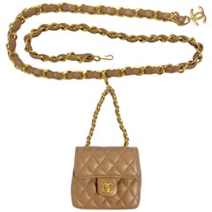 Vintage CHANEL brown lambskin mini 2.55 bag charm chain leather belt with CC.