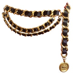 Vintage CHANEL black leather golden chain belt with CC and mademoiselle charm.
