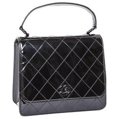Vintage CHANEL Flap Bag in Black Patent Leather with Quilted Stitching