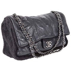 CHANEL Flap Bag in Black Wool and Aged Leather