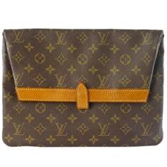 70's vintage Louis Vuitton monogram envelope style document portfolio purse.