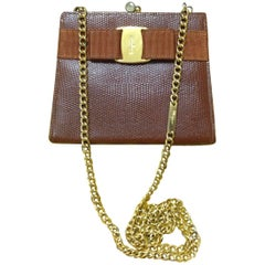 Vintage Salvatore Ferragamo brown lizard embossed leather golden chain clutch.