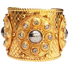 1990s Christian Dior gilded metal cuff bracelet with rhinestones and cabochons