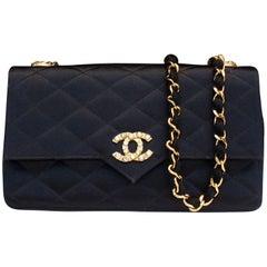 Chanel black satin clutch with golden hardware