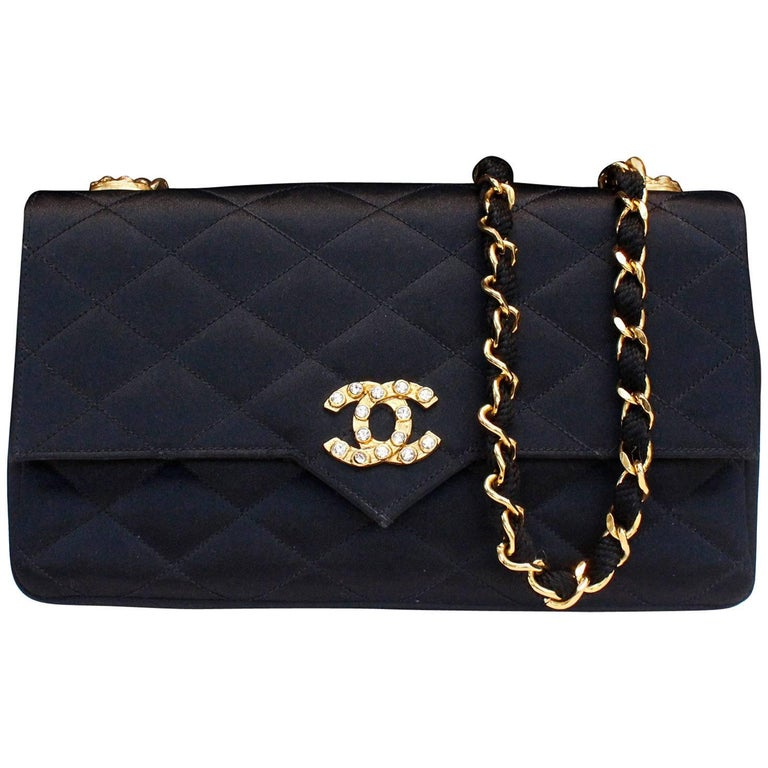 Chanel black satin clutch with golden hardware For Sale