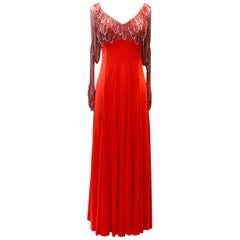 1970s Loris Azzaro (attributed to) long red and silver jersey and knit dress