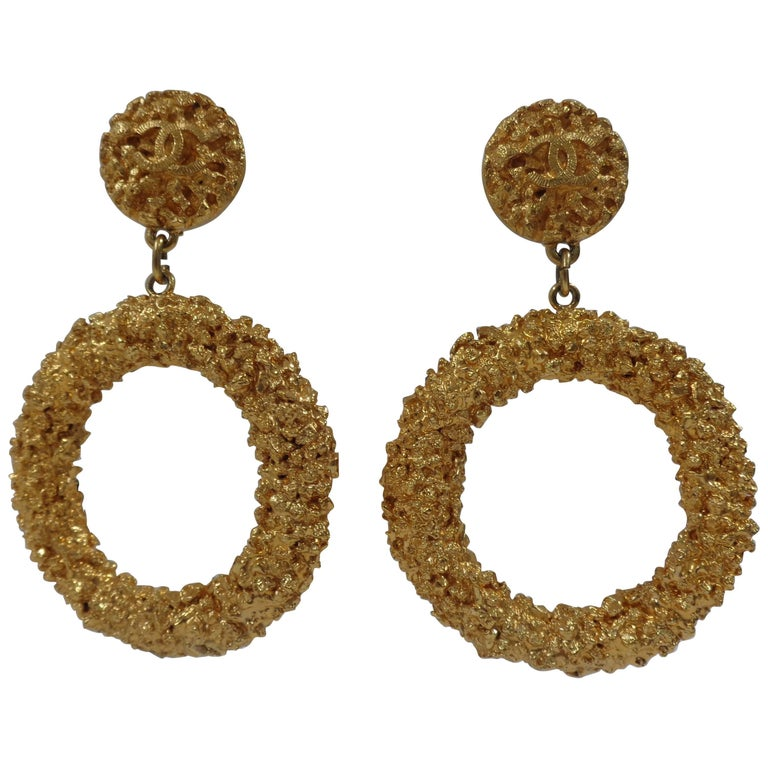 Chanel gold tone circle cc logo clip on earrings For Sale