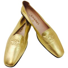 Shimmering Chanel's Metallic Gold Lambskin Loafers with CC Logo At Top