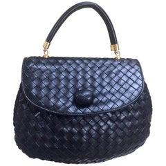 Vintage Bottega Veneta black intrecciato, woven lambskin handbag. Classic purse.