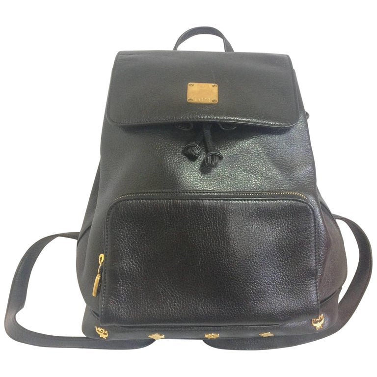 Vintage MCM black backpack with golden studded logos. Designed by Michael Cromer