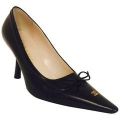 Classic Chanel Black Pointed Toe Pumps With Leather Ties