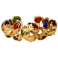 1990s, Chanel gilded metal bangle with glass paste cabochons