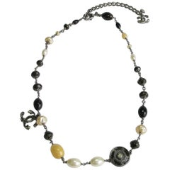 CHANEL Necklace in Silver Plated Metal, CC, Medal and Pearls