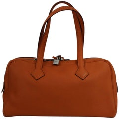 2011 Hermes Victoria Bag in Orange Clemence Taurillon Grained Leather.