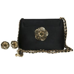 CHANEL Set : Evening Bag in Black Satin, Gilded Metal Clip-on Earrings and  Ring