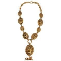 Chanel Gold Tone Medallion Necklace with Crowns and Horse Dangle, 1980s