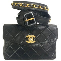Vintage CHANEL black waist purse, fanny pack with golden CC and chain belt.