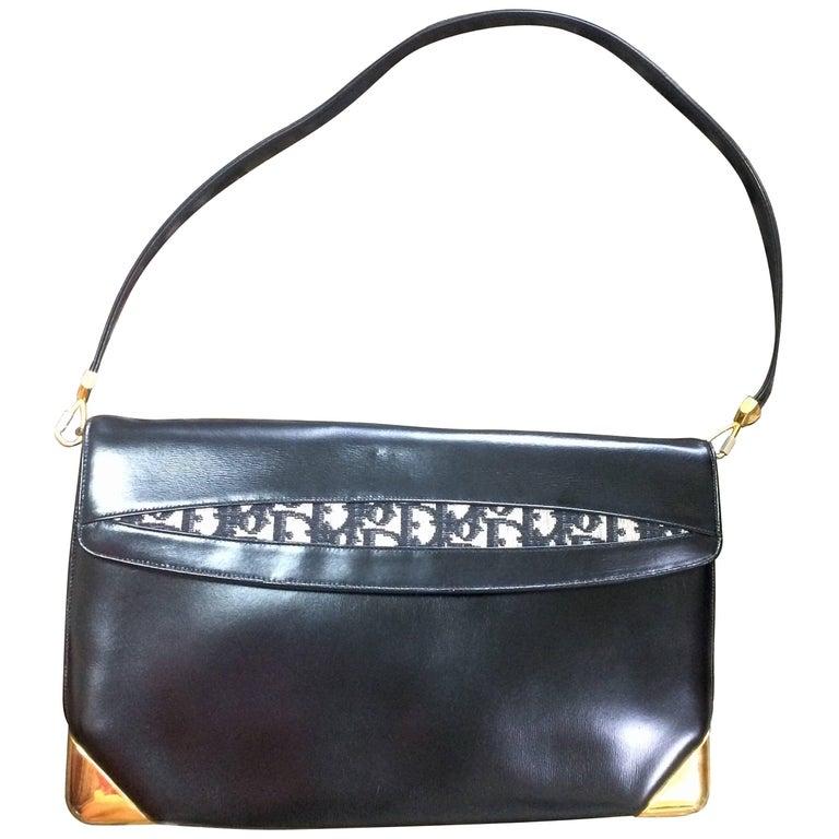 Vintage Christian Dior black leather large clutch, shoulder bag with trotter. For Sale