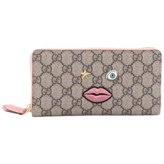 Gucci Zip Around Wallet GG Coated Canvas with Face Applique