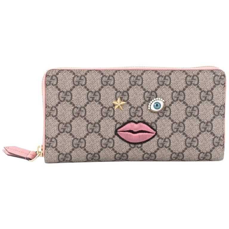 gucci zip around wallet gg coated canvas with face applique at 1stdibs