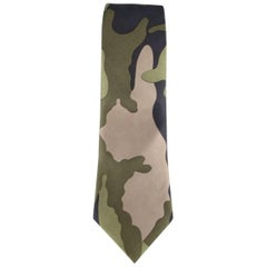 VALENTINO dress tie comes in large scale camouflage print with hues of olive gre