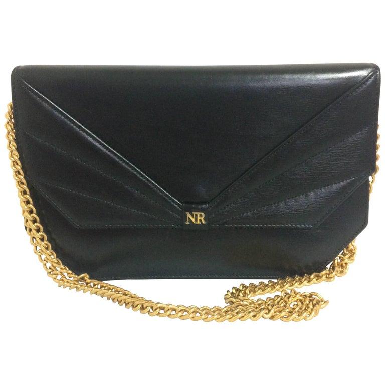 Vintage Nina Ricci black leather chain clutch shoulder bag with a bow stitch