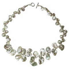Necklace of White Iridescent Keshi Pearls with Sterling Toggle