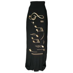 1990s Moschino Gold Music Note Print Black Pleated Maxi Skirt
