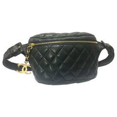 Vintage CHANEL black leather waist bag, fanny pack with belt and golden CC motif