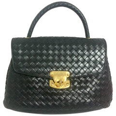 Vintage Bottega Veneta classic black lamb leather intrecciato handbag.