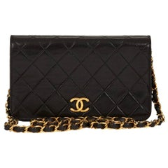 1990s Chanel Black Quilted Lambskin Vintage Mini Flap Bag
