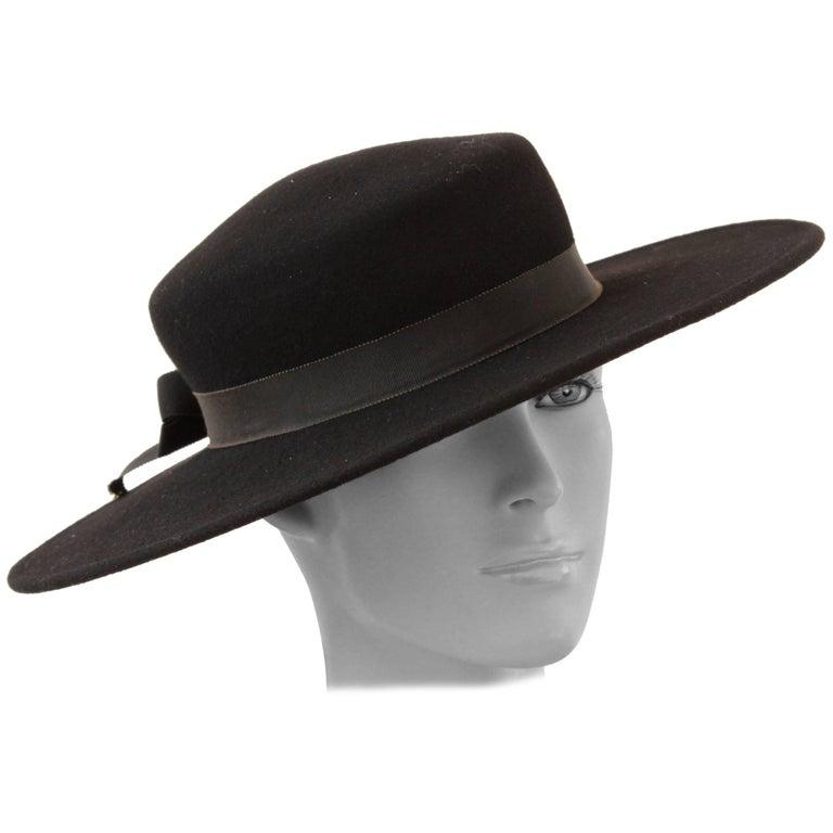 af741d3096f 70s Yves Saint Laurent Wide Brim Hat Black Wool by Bollman Hat Co Sz S For