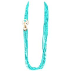 Ciner Turquoise Glass Torsade Necklace with Crystal White Enamel Elephant Clasp