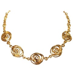1980's YVES SAINT LAURENT abstract rose gilt necklace