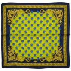 MINT. Vintage Gianni Versace yellow, blue, green, gold, and flower motif scarf.