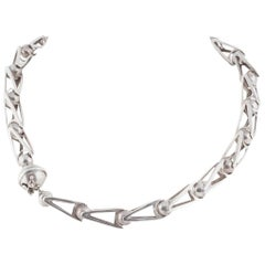 Hand made dynamic articulated ball and triangle sterling silver necklace