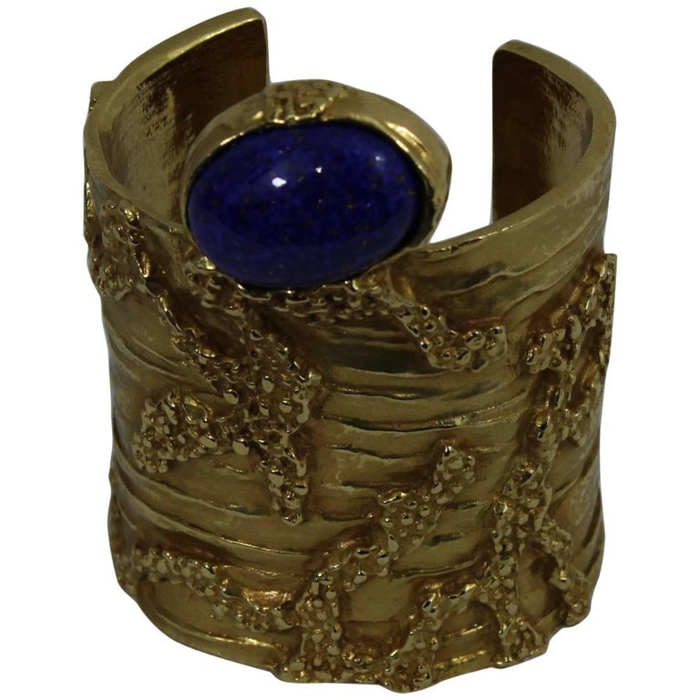 fb0d740ebe8 Yves saint Laurent Gold Artsy Bangle with Blue Stone For Sale at 1stdibs